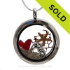 Ruby Red Real sea glass pieces combined with a real starfish a sterling hearts charm, a ruby red gem and real beach sand in this  silver locket.