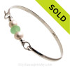 Two Large Freshwater Pearls combined with a vivid Sea Green Genuine Sea Glass piece on this Solid Sterling  Half Round Bangle Bracelet.