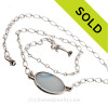 A great necklace that is totally  handmade here in the By The Sea Jewelry Studio. An amazing combination of vivid electric aqua and Carolina blue in this very old English Sea Glass piece and set in our Original Wire Bezel© necklace pendant setting