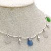 A detail of the piece shows you how the sea glass is attached and dressed and the quality of the wire work.