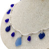 A center of light blue surrounded by cobalt blue glass  beads and beach found sea glass.