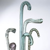 Glass canes were called whimsies or friggers and were made by the glass artists to practice their trade. They were impractical for support of walking but were used in parades and generally passed down in families.
