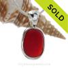 Flat Deep Ruby Red Seaham Sea Glass Pendant In Deluxe Wire Bezel© In Sterling Silver (ULTRADELUXE21-33)