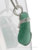 A side view shows you the thickness of the sea glass and the quality of the silver wrap.