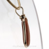 A side view shows you the flatness of the sea glass in this piece of jewelry.