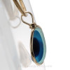 A side view shows you the mixture of colors and the thickness of the sea glass in this jewelry piece.
