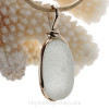 A prefect  and lovely thick pure white sea glass set in our Original Wire Bezel© pendant setting with 14K rolled gold.