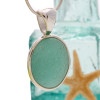 A beautiful vivid aqua green sea glass pendant in our deluxe sterling setting. This is the EXACT pendant necklace you will receive! Just like like piece of our jewelry that was featured in Coastal Living Magazine!