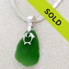 A HUGE vivid green sea glass piece with solid sterling kissing dolphins. Sorry this necklace has sold!
