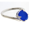 A vivid cobalt blue sea glass piece that is UNALTERED from the way it was found on the beach. Unlike most jewelers that cut a stone to fit a setting, we hunt through 1000's of pieces to find the perfect fit for our sea glass rings. This is the EXACT sea glass ring you will receive!