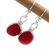 Red Sea Glass is said to be one in 100,000 piece of sea glass found on the beach. This almost perfect matching pair is a once in a lifetime set or earrings.