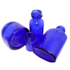 Cobalt blue sea glass can originate from many sources. Noxzema, Phillips Milk Of Magnesia and Bromo Seltzer to name a few. These pieces are fairly thin (though perfectly smooth) and that indicates there were most likely from a Phillips Bottle.