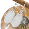Long ovals of pure white natural sea glass set in our signature Original Wire Bezel© setting. This sea glass is totally UNALTERED from the way it was found on the beach. This is the EXACT pair you will receive!
