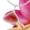 An awesome mixture of hot pink and gold fused inside this incredible sea glass piece from England. Set in sterling silver, this is a beautiful pendant for any necklace.