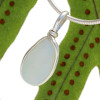 Incredibly rare opalized GENUINE English sea glass in our Original Wire Bezel© setting. Opalized glass is incredibly rare. In natural light it glows a yellow and blue hue.  This is a one of a kind piece and the EXACT pendant you will receive!