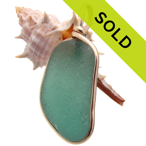 A beautiful piece of deep aqua green sea glass is set in our signature Original Wire Bezel© setting the securely encases the sea glass and leaves it totally unaltered from the way it was found on the beach.  TOP QUALITY CERTIFIED GENUINE SEA GLASS!