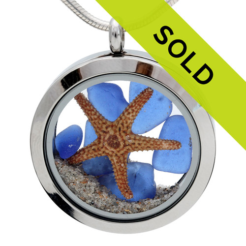 This blue sea glass and starfish locket has been sold!
