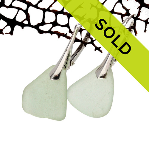 Pale seafoam green sea glass pieces shaped only by the sea, sand and time are suspended on solid sterling leverback earrings. Sorry these sea glass earrings have been sold!