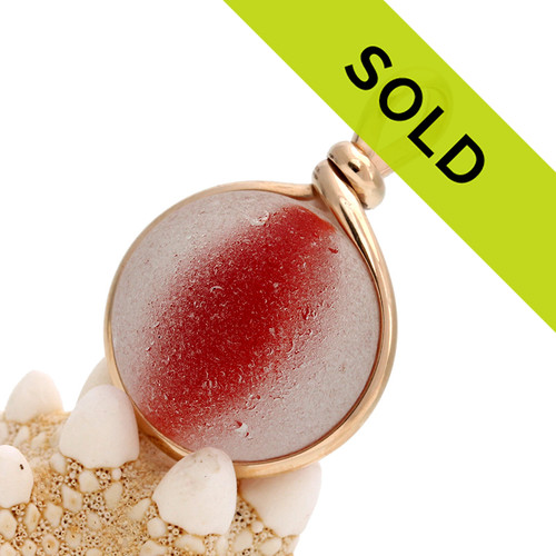 Sorry this beautiful red orange catseye marble in gold has been sold!
