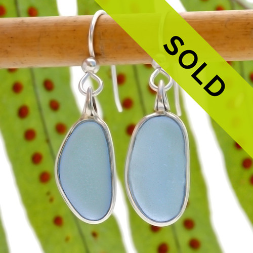 Genuine light blue (sometimes called periwinkle or cornflower blue) is set in our Deluxe Wire Bezel© setting that leaves the sea glass pieces UNALTERED from the way they were found on the beach. A lovely rare pair of sea glass earrings!