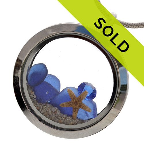 September birthstone of sapphire gemstone and blue sea glass combined in a stainless steel locket. Sorry this locket has sold!