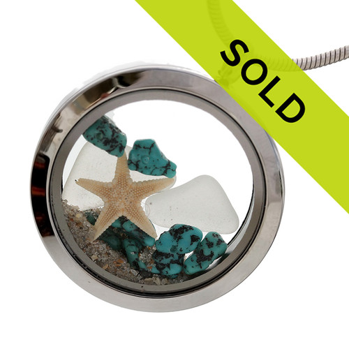 "White natural sea glass are combined with a real starfish and real turquoise beads in a stainless steel locket. Real beach sand completes your own personal ""Beach On The Go""!  THIS LOCKET HAS BEEN SOLD"