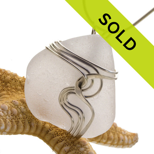 This white sea glass pendant in our waves sterling wire setting has been sold!