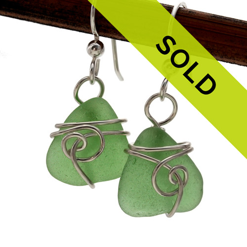 Green sea glass pieces set in our Sea Swirl sterling wire EARRING  setting. GENUINE UNALTERED sea glass just the way it was found on the beach!  SORRY THESE HAVE SOLD!