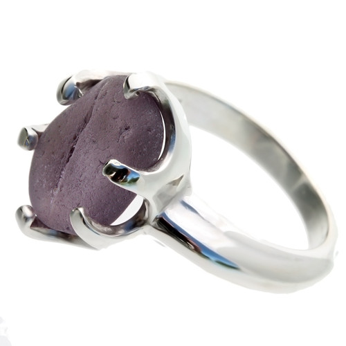 This amazing piece of deep purple English sea glass was left just the way it was found on the beach. It is set in a professional grade solid sterling cast ring.