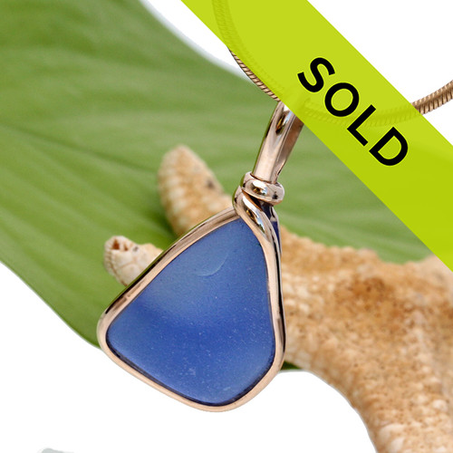 This is a LARGE Carolina Blue color and an old thicker piece of naturally found sea glass in my Original Gold Wire Bezel© This setting leaves the glass UNALTERED from the way it was found on the beach and maximized the gold for wow factor. Sorry this one of a kind sea glass jewelry piece has been sold!