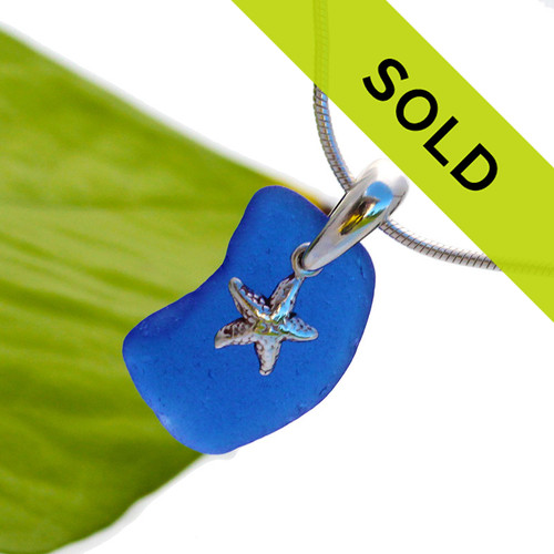LARGE Cobalt Blue Sea Glass Necklace Pendant With Sterling Bail W/ Starfish Charm  A large ALMOST perfect piece of rich cobalt blue sea glass set on a hand cast solid sterling silver bail with a sterling starfish charm.  This piece has been sold!