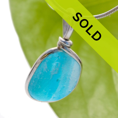 A vivid aqua multi color sea glass from Seaham England set in our Original Wire Bezel© setting. This unusual sea glass is a result of art glass factories during the Victorian era tossing waste and slag glass into the sea.  Sorry this piece has sold!