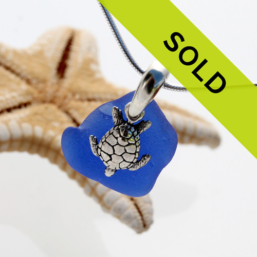 Beach found blue sea glass is combined with a handcast solid sterling bail and finished with a sterling silver sea turtle charm. This piece has been SOLD!