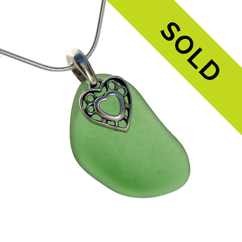Perfect curvy green sea glass is combined with a solid sterling heart charm and comes on an 18 Inch solid sterling snake necklace chain.