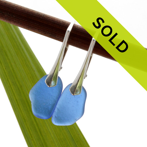 Genuine blue beach found sea glass is set on these TOP QUALITY lever back earrings for an elegant polished look!