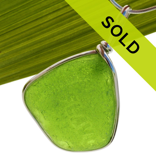 This genuine lime green sea glass pendant in silver bezel has been sold!