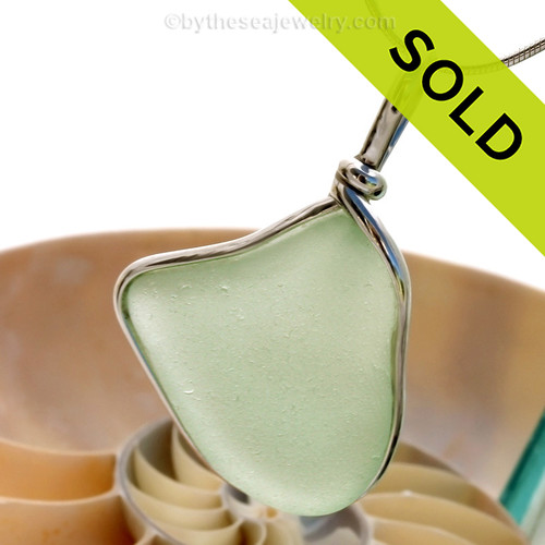 beautiful piece of seafoam green sea glass set in our Original Wire Bezel pendant setting. This leaves the sea glass piece totally unaltered from the way it was found on the beach! Sorry this Sea Glass Jewelry selection has been SOLD!