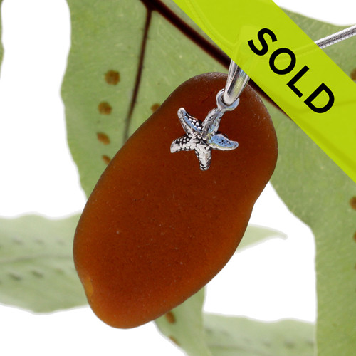 """Long large amber brown sea glass set with a sterling bail and solid sterling starfish charm. This piece INCLUDES the 18"""" solid sterling snake chain (shown)."""