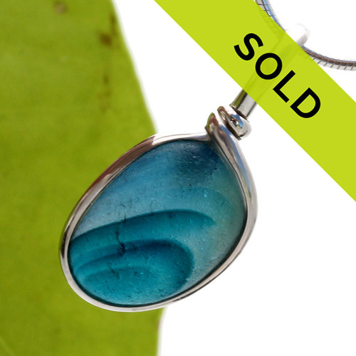 A stunning piece of mixed aqua blue sea glass set in our Original Wire Bezel©. Sorry this sea glass necklace pendant has sold!