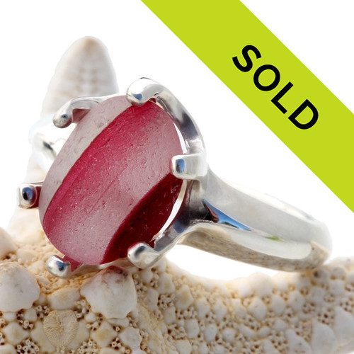 A STUNNING mixed hot pink sea glass piece from Seaham England is set in a hand cast solid sterling ring base. The sea glass has been loosely set so that it can be removed for ring sizing.  Sorry this one of a kind ring has been SOLD!