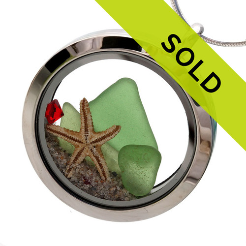 Green sea glass is combined with real starfish and vivid red gemstones for a holiday inspired sea glass locket. Sorry this locket has SOLD!