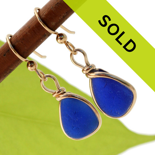 Sorry this pair of blue sea glass earrings in gold have been SOLD!