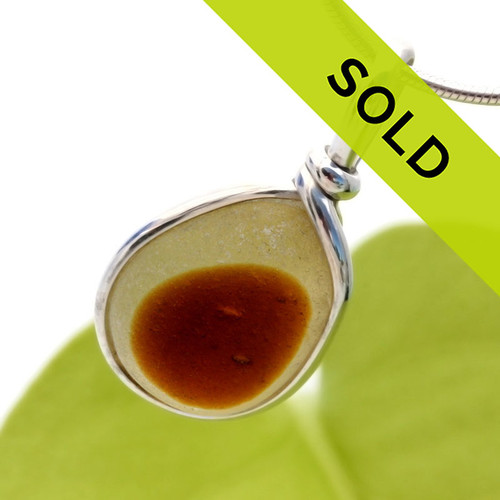 A very autumnal piece of sea glass from England set in our Original Wire Bezel© necklace pendant setting. Sorry this sea glass jewelry selection has been sold!