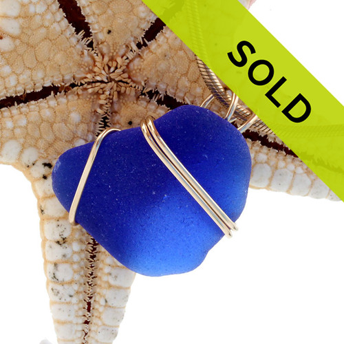 Sorry this blue sea glass necklace pendant in gold has sold!
