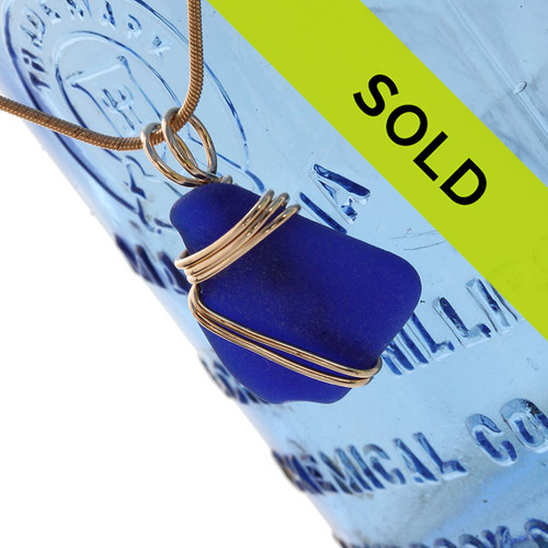 A vivid cobalt blue sea glass piece set in our triple rolled gold pendant setting. This maximizes the bling of the gold while leaving most of the sea glass open and UNALTERED from the way it was found on the beach!  Sorry this piece has SOLD!