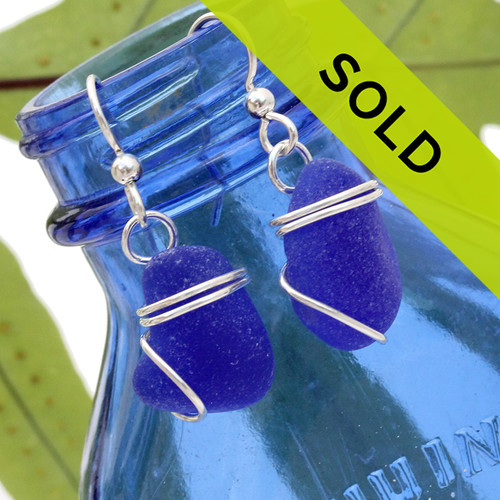 Chunky blue sea glass pieces set in a simple sterling setting! A nice pair of genuine blue sea glass earrings.