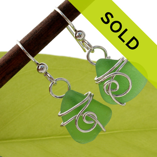 Smaller pieces of natural green sea glass set in a simple sea inspired earring setting. This pair has SOLD!