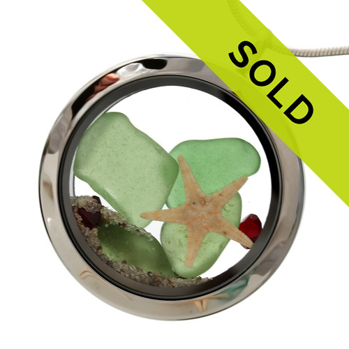 Green sea glass and vivid red gemstones make this a great locket necklace for the holidays. Sorry this piece has sold!