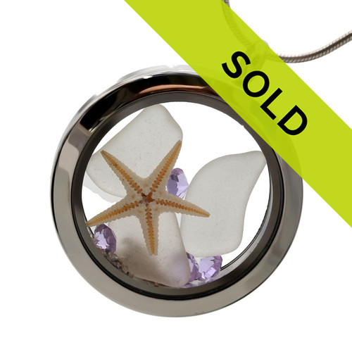 Pure white sea glass combined with a real starfish and beach sand and brightened up with amethyst gems.  Great choice for a February Birthday!