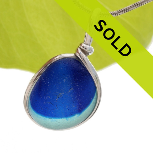 Flashed mixed aqua and vivid blue sea glass from the UK set in our Original Wire Bezel© necklace setting. SOLD